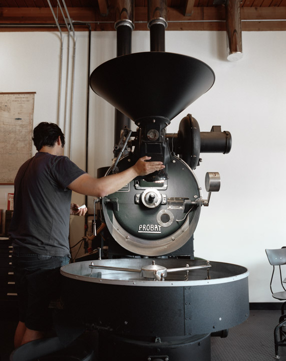 Industrial coffee roaster sits the center of the cafe. Image:  Neil DaCosta