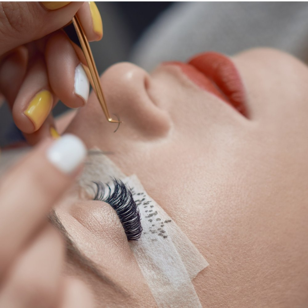 beauty-treatment-applying-false-eyelashes-picture-id679782838.jpg