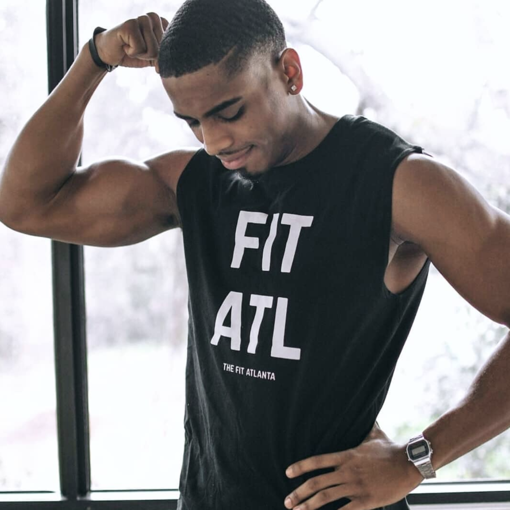 THE ORIGINAL MUSCLE TANK - UNISEX   This muscle tank is perfect for all shape and sizes. Fits true to size. For a tighter fit, go down a size. This tank will guarantee you'll look dope working out. Expect to turn heads in our original fan favorite! | Jamaal is wearing a size large.