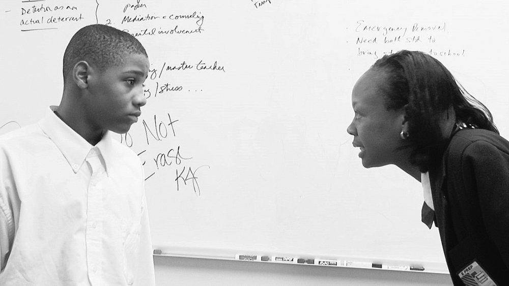 """Tyree, left, and school disciplinarian Ms. Joyner at E Prep, the charter school on Cleveland's East 36th Street featured in """"Facing Forward,"""" a documentary airing on WVIZ/PBS in May. ( Laura Paglin )"""