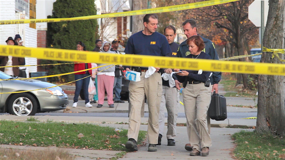 The FBI works at the home of Anthony Sowell in 2009, shortly after the bodies of 11 decomposing women were found at his Imperial Avenue house. Cleveland Heights filmmaker Laura Paglin has just released 'Unseen,' a documentary featuring those who survived incidents with Sowell. (Laura Paglin)