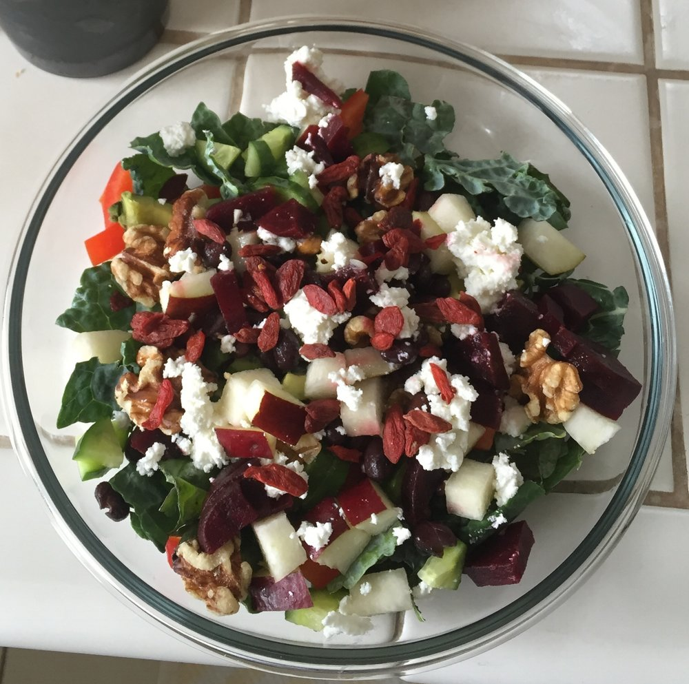 MY SIMPLE TREAT SALAD - A blend of coolness, sweet and tart with a earthly vibe. This is one of my treat simple salads. The pear and gogi add sugar, but the blend of veggies, nuts and goat cheese kick the boring salad stigma to the curb.