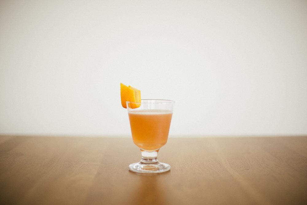 ingredients: - 1 1/2 oz rye whiskey1 oz dry vermouth3/4 oz fresh lemon juice1/2 oz grenadine2 dashes orange bittersGarnish: orange zest