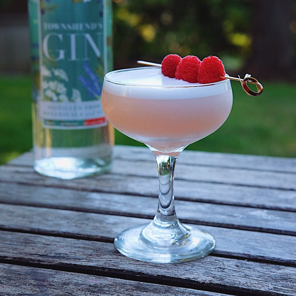 ingredients: - 2 oz gin1/2 oz fresh lemon juice1/2 oz raspberry simple syrup1 egg whiteGarnish: 3 skewered raspberries