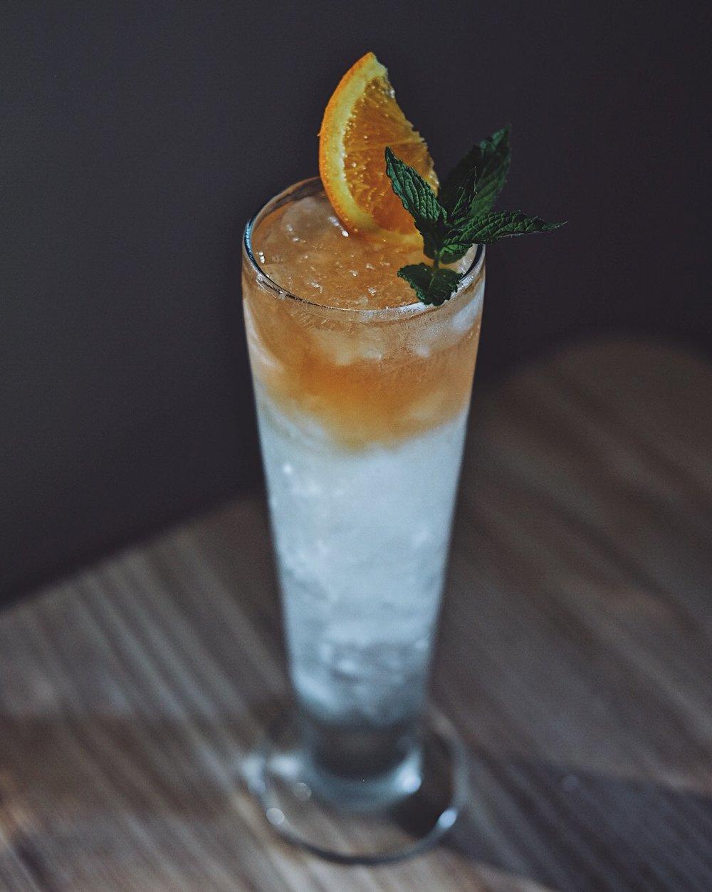 ingredients: - 1 oz bourbon1oz dry gin1/2 oz fresh lime juice1/4 oz Demerara syrup2 dashes aromatic bitters4 oz ginger beerGarnish: Fresh mint & orange wheel