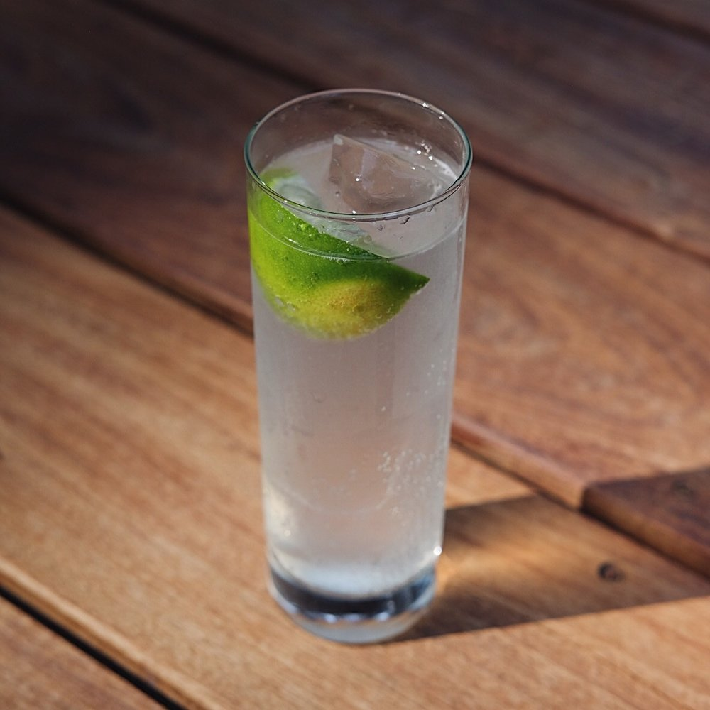 Gin Rickey - 2 oz gin1/2 of a limesoda waterice