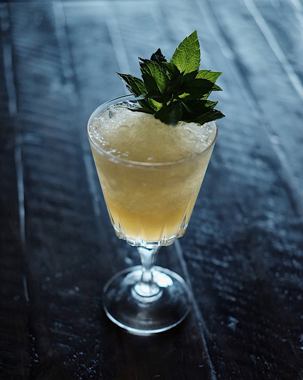 ingredients: - 1 1/2 oz blended scotch3/4 oz fresh lemon juice1/2 oz yellow chartreuse1/8 oz Galliano1/2 oz honey syrup4 dashes lavender bittersGarnish: fresh mint