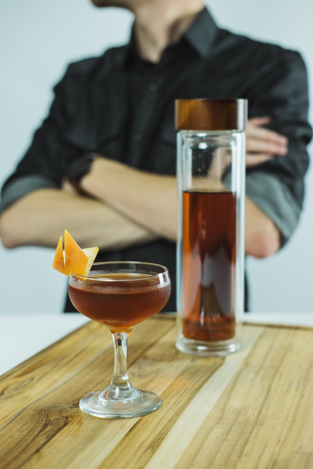 ingredients:  - 1 1/2 oz chocolate-infused reposado tequila1/2 oz mezcal1/2 oz Ancho Reyes chili liqueur2 dashes aromatic bittersA few drops of agave nectarGarnish: Orange peel