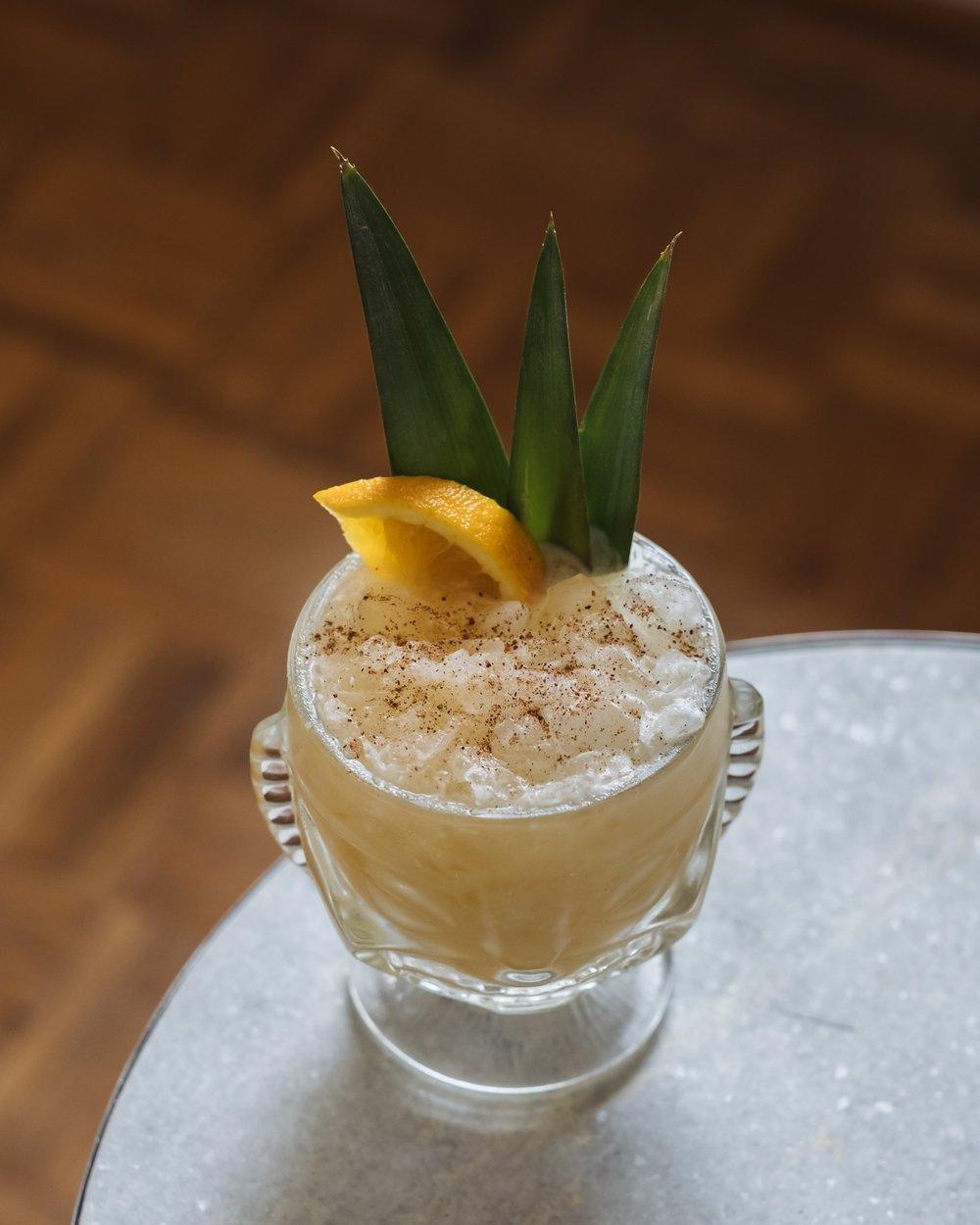 ingredients - 2–4 oz of Pusser's Navy Rum4 oz unsweetened pineapple juice1 oz freshly squeezed orange juice1 oz cream of coconut