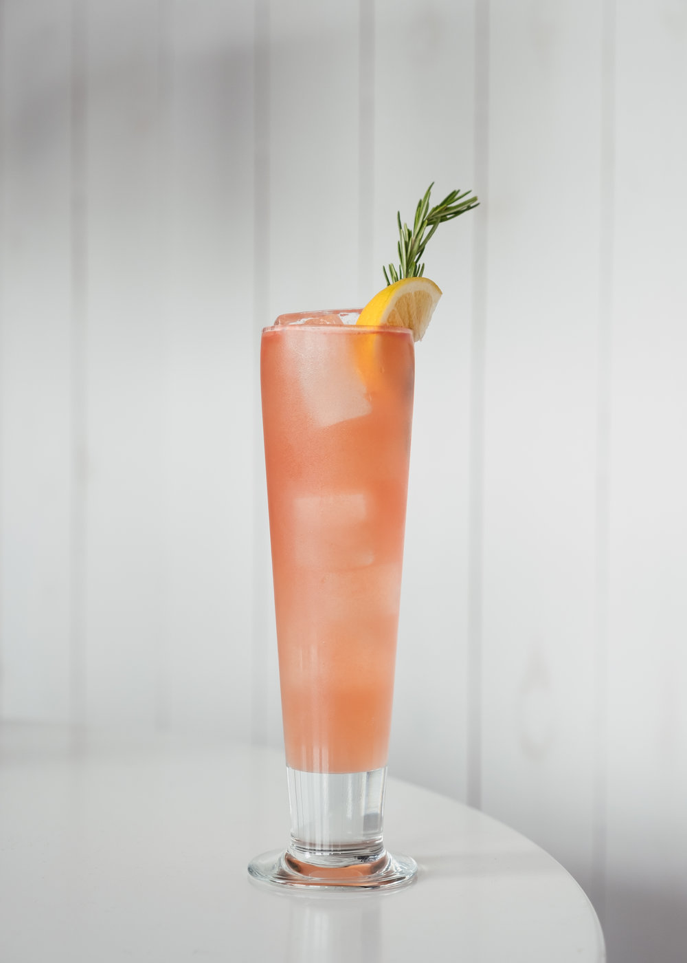 ingredients - 2 oz Citrus-forward gin¾ oz ginger liqueur1 oz fresh lemon juice½ oz *Rosemary simple syrup3-4 one-inch cubes of watermelonDry lemon soda