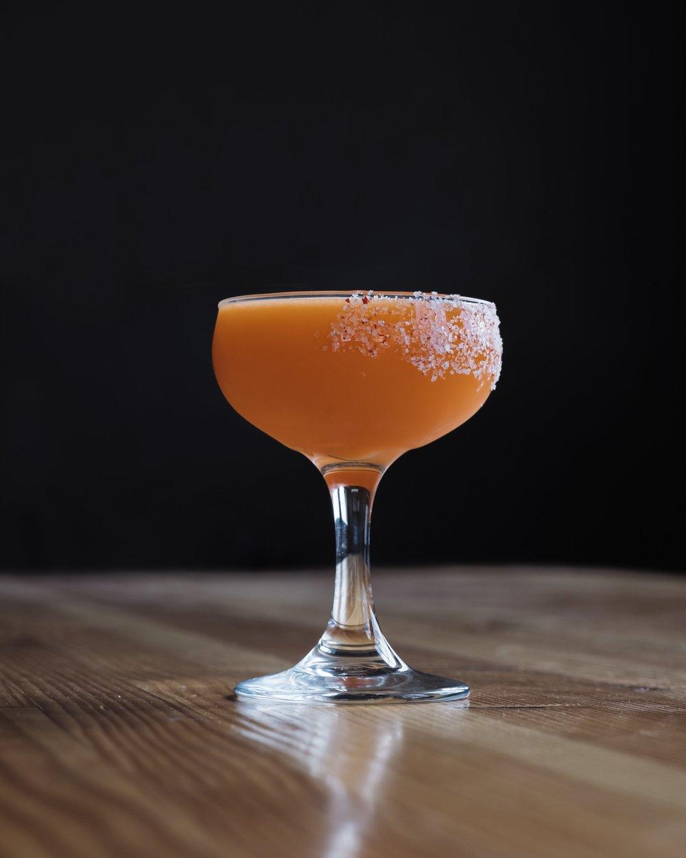 ingredients: - 1¾ oz Mezcal½ oz cinnamon syrup¾ oz fresh lime juice¾ oz fresh carrot juice2 dashes orange bitterssalt & pink peppercorns for rim