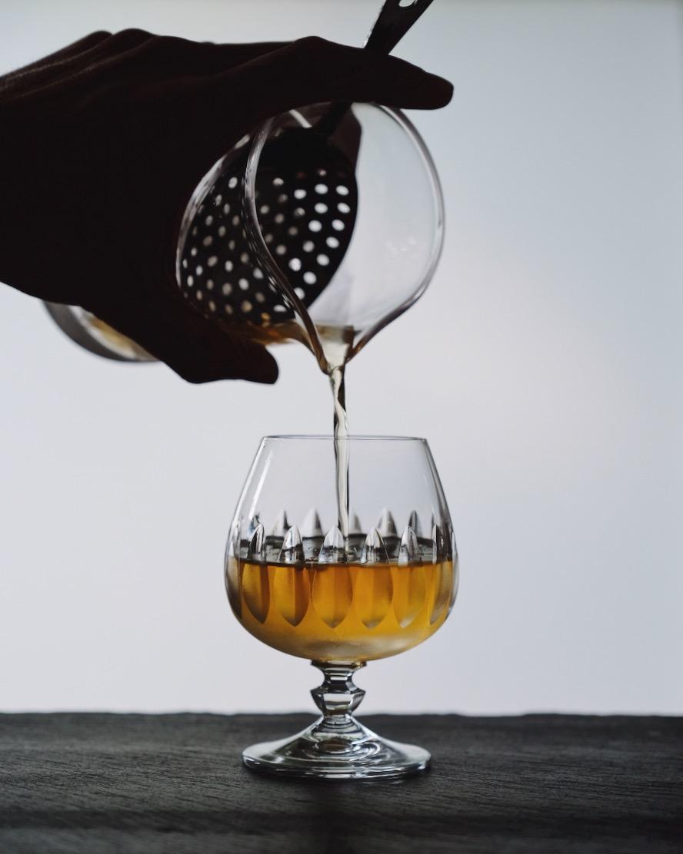 ingredients: - 2 oz Irish whiskey1/2 oz St. Germain Elderflower liqueur1 dash of orange bittersLaphroaig 10 year scotchLemon zest