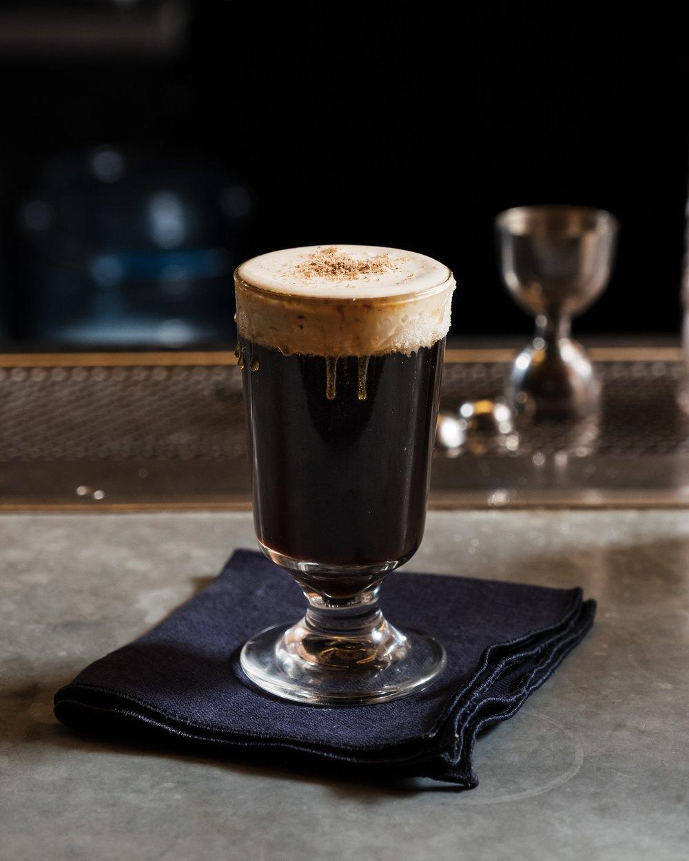 ingredients: - 3/4 oz 151-proof rum1/4 oz triple sec1 1/2 oz coffee liqueur3 oz freshly brewed coffeeSuper fine sugarNutmeg