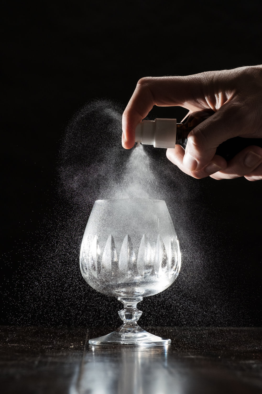 ingredients: - 1 oz high-proof rye whiskey1 oz Cognac2 dashes Peychaud's bitters2 dashes Aromatic bitters1 tsp Demerara syrupAbsinthe rinseLemon zest