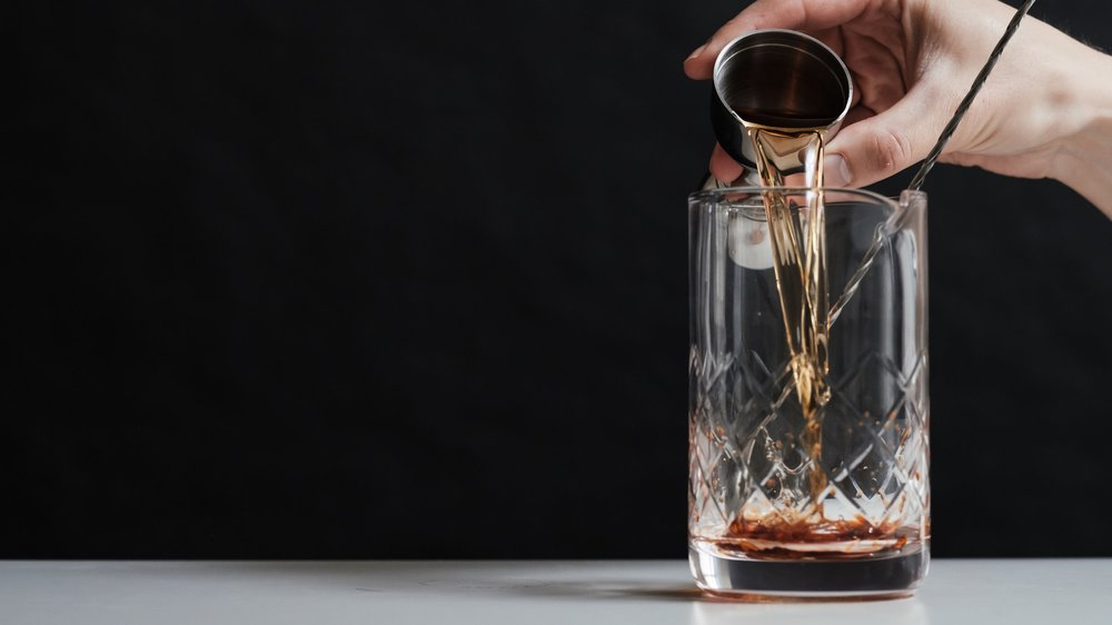 Pour 2 ounces of whiskey - (or any other spirit you like!)