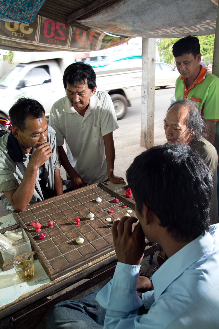 A group of Thai men playing a game of Makruk in Suratthani, Thailand