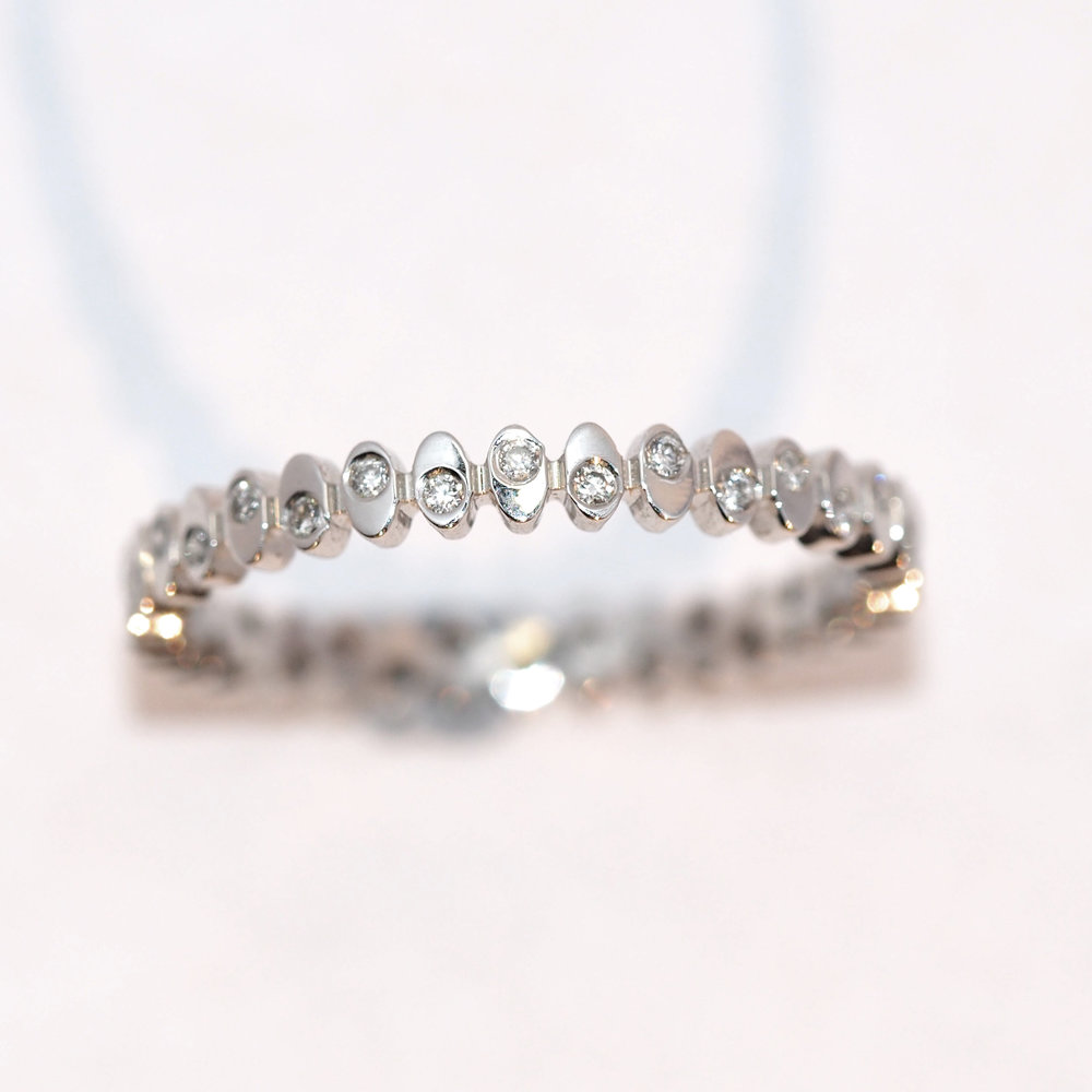 Penelope  Looking for something a little different? How about this stunning diamond set pebble ring, these tiny diamonds are scattered all the way around the wedding band.