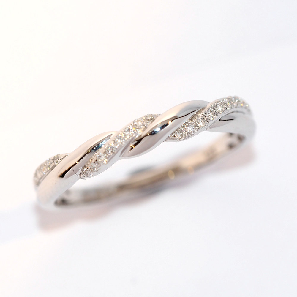 belle  This beautiful diamond set wedding ring would make a stunning addition to any jewellery box. Measuring approximately 3mm at the widest point it compliments and engagement ring perfectly.