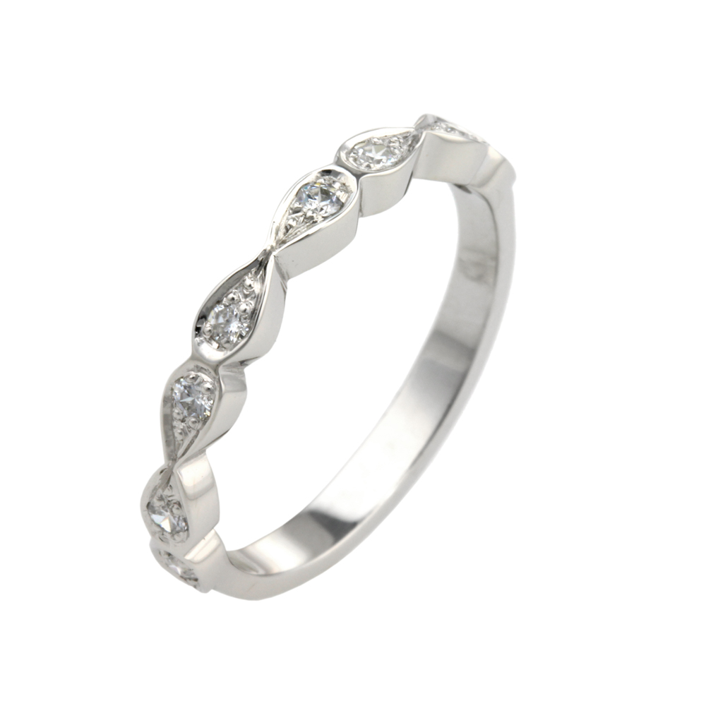 iris  A Vintage Inspired diamond set ring, each petal is set with one round brilliant diamond. Made to order, allow four weeks for delivery.