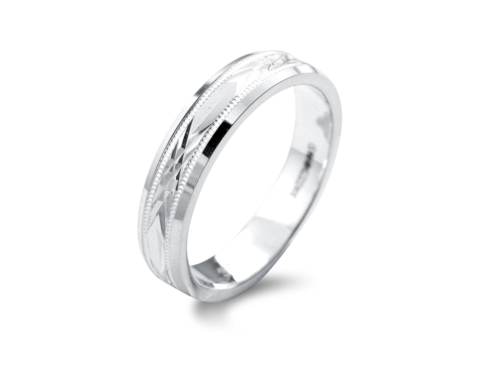 lily  A Diamond Cut Wedding Ring, with mill grain detail and a polished finish. Stunning for the bride or groom looking for a little extra sparkle without the added cost of diamonds. Made to order in a number of different colours, widths and metals