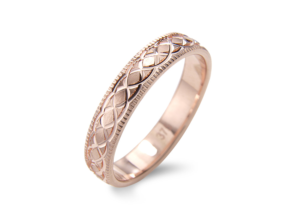 aina  A Celtic Style Wedding Ring, with mill grain detail to the edging (3mm shown). Made to order in a number of different colours, widths and metals