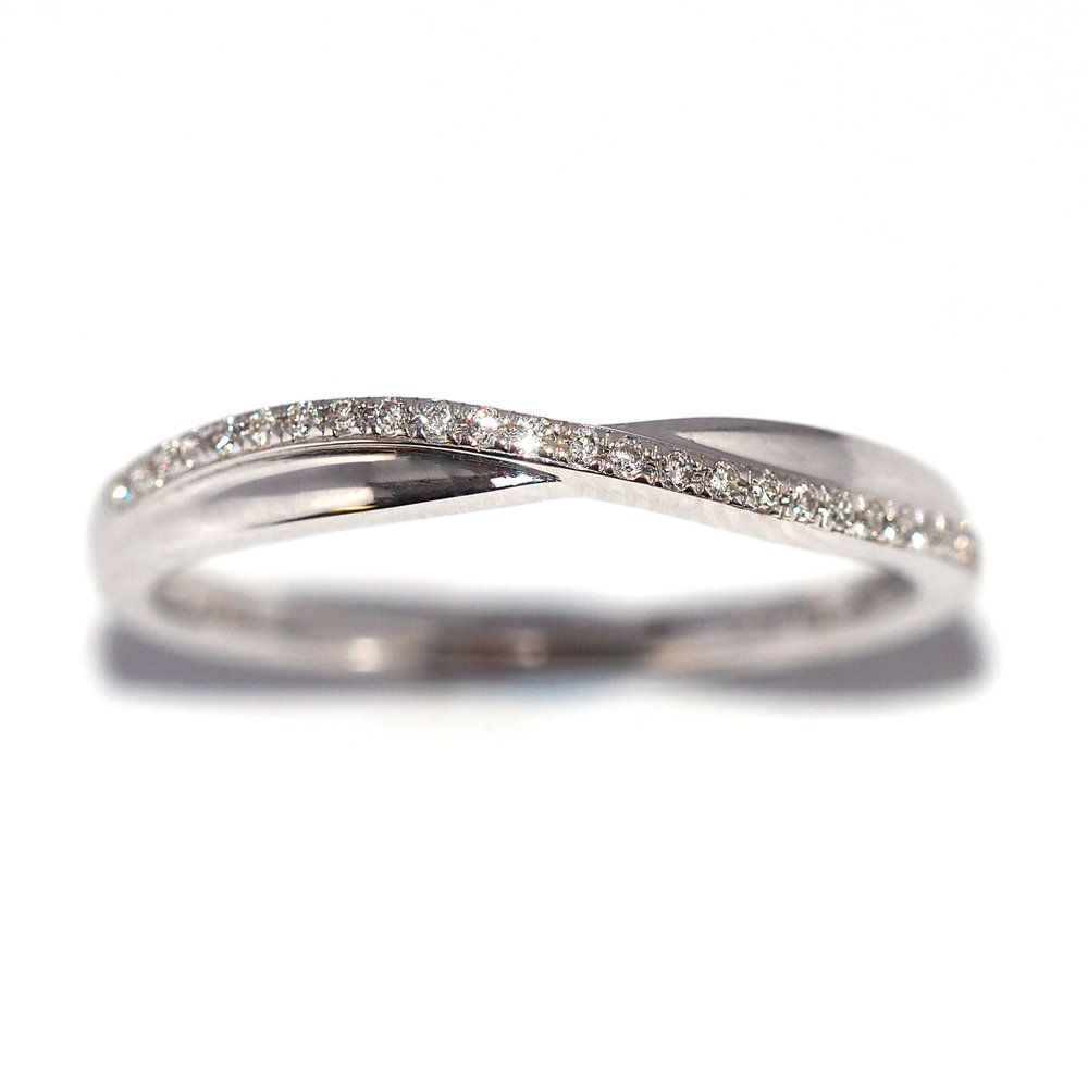 SARAH  A Diamond set wedding band, with wave detail having one row of diamonds 0.070ct.   Available in 9ct, 18ct, White, Rose and Yellow Gold and Platinum.