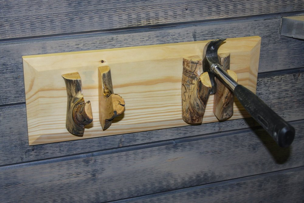 The magnets that hold the skis to the wall are strong enough to hold a hammer.