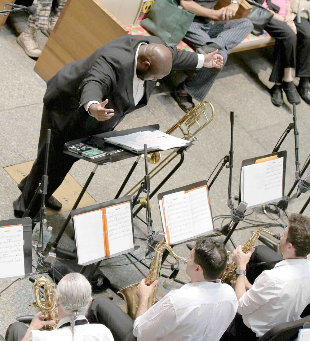 David White, music director of the David White Jazz Orchestra conducting the DWJO. Saint Peter's Church Midday Jazz New York, NY