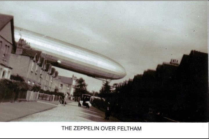 The Zeppelin over Feltham in the 1930's going to land at Hanworth Park. At the end of Danesbury Road, going over the top of Alfred Road, Feltham.