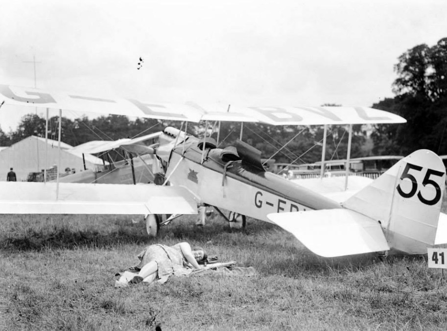 Hanworth Air Park on the 6th July 1930. Miss Winifred Sawley Brown [1899-1984] lying next to her plane in rediness to take part in the King's Cup Air Race in her Avro Avian at an average speed of 102.7 mph [against over one hundred other pilots] starting & finishing at Hanworth Aerodrome, Middlesex covering a distance of over 750 miles on the 6th July 1930.[Eventual winner]. From Ebay.