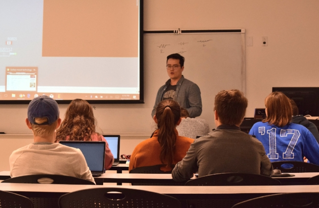 On another day, Connor Morris teaches new members how to work with Autodesk's Eagle program, which is used to design and implement circuit boards.