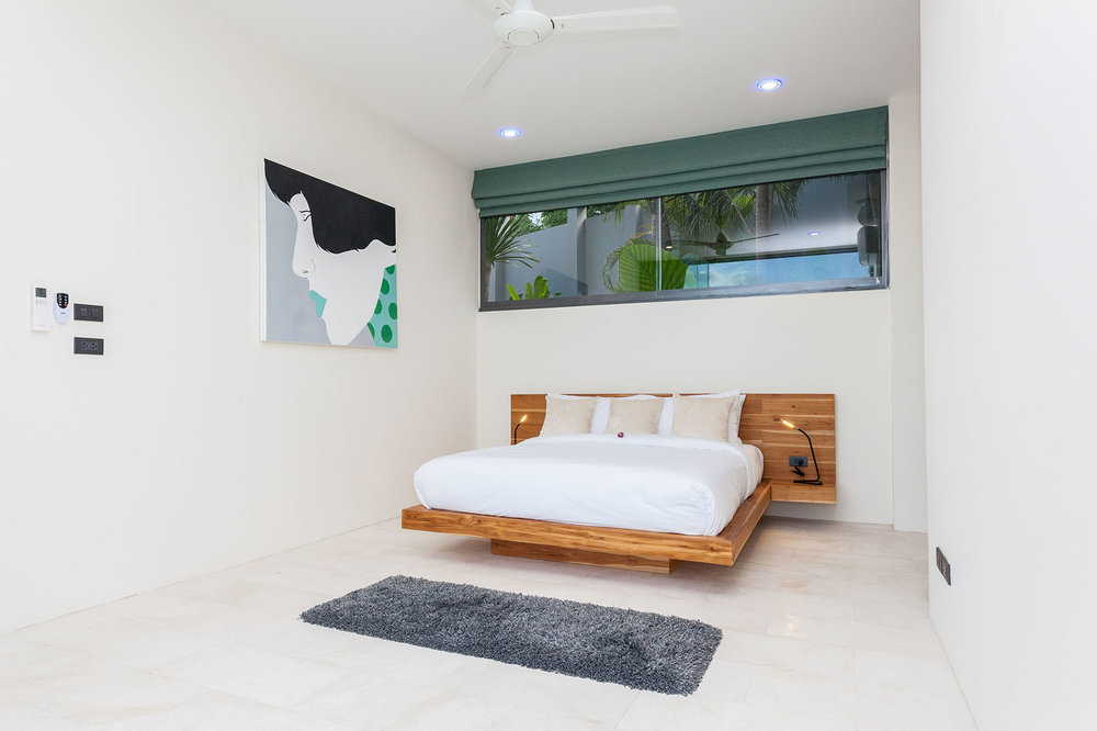 Bedroom with wooden king-size bed
