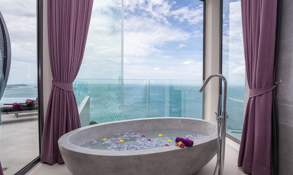 Bath overlooking the sea