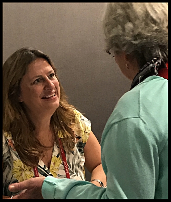Elly Griffiths signing a book for a fan at Bouchercon 2018.jpg