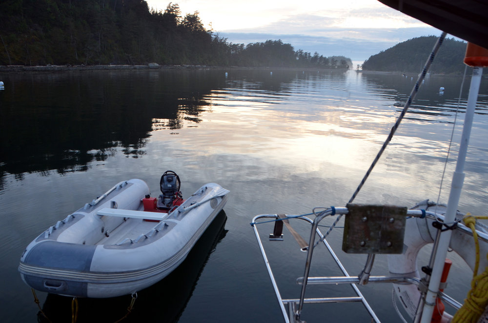 Safe, easy loading of outboard motor to dinghy (photo: Sucia Island, Washington State)