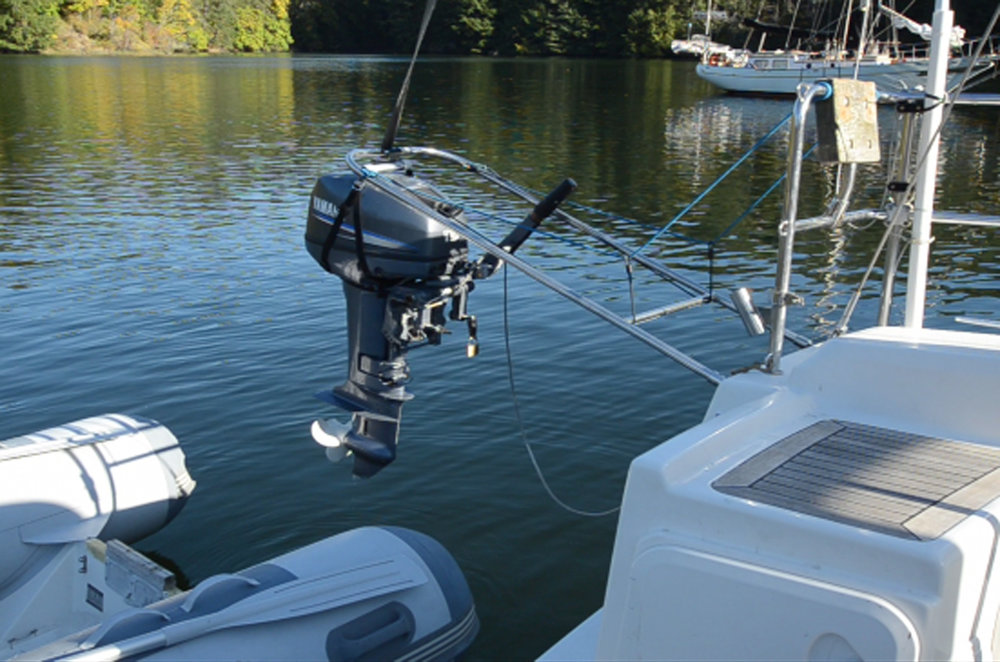 Easy single-handed hoisting of outboard motor to yacht rail (photo: Tod Inlet, Vancouver Island BC)