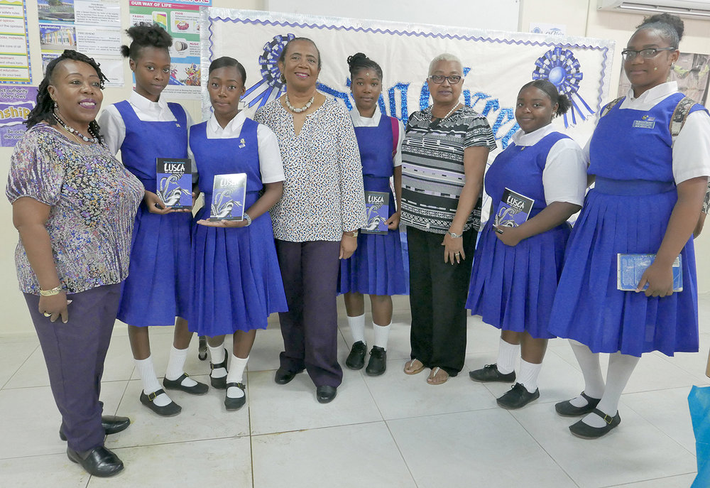 Linda Fisher, librarian, the Government High School; Siding Whyms; Daniella Dorsett; Patricia Glinton-Meicholas, author, Lusca and Other Fantastic Tales; Deonte Charles; Teresita Forbes, vice-principal, the Government High School; Ashlyn Sands and Benet Johnson.