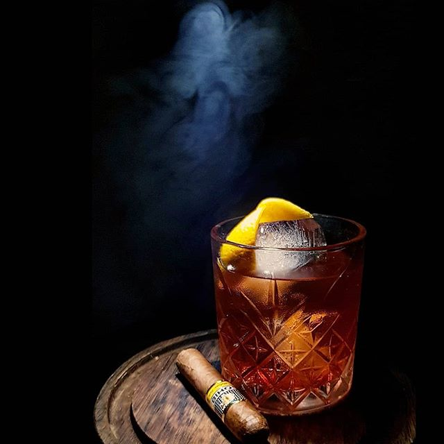 The Cuban Negroni.  South's twist on the classic with almond infused gin, dark chocolate bitters, Ceylon cinnamon syrup,  smoked with Cuban Cigars as part of Negroni Week. #imbibe #negroniweek #campari #camparinigeria