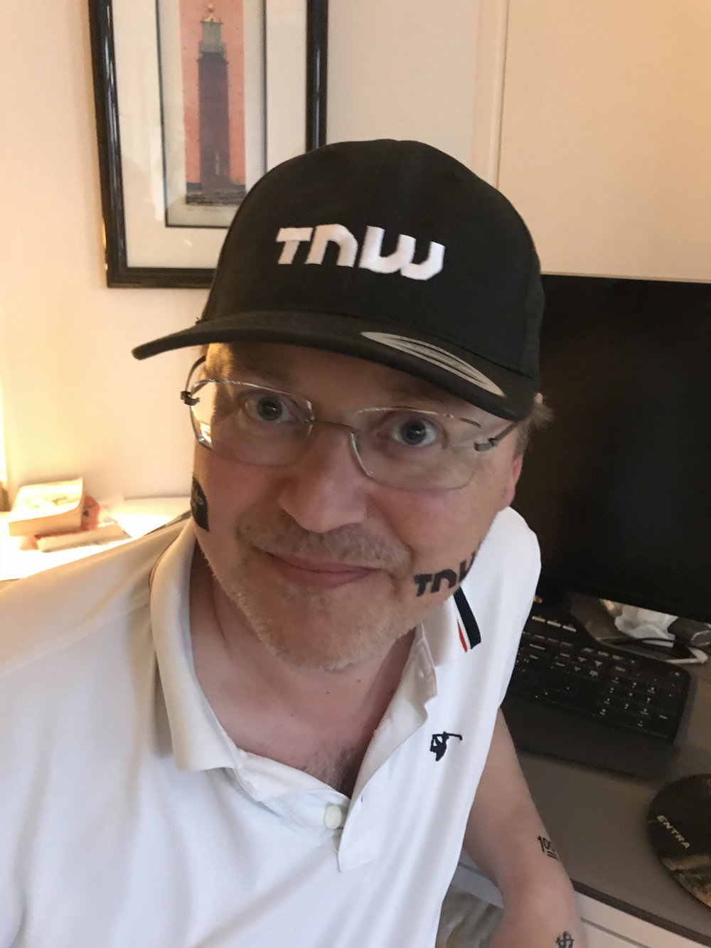 TNW CEO Boris gave Christopher a matching TNW cap