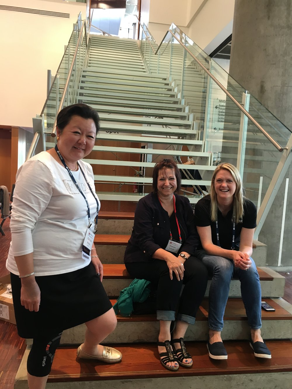 Tired feet at EclipseCon, Nathalie Mindus with Sharon Corbett and Jennifer Martel