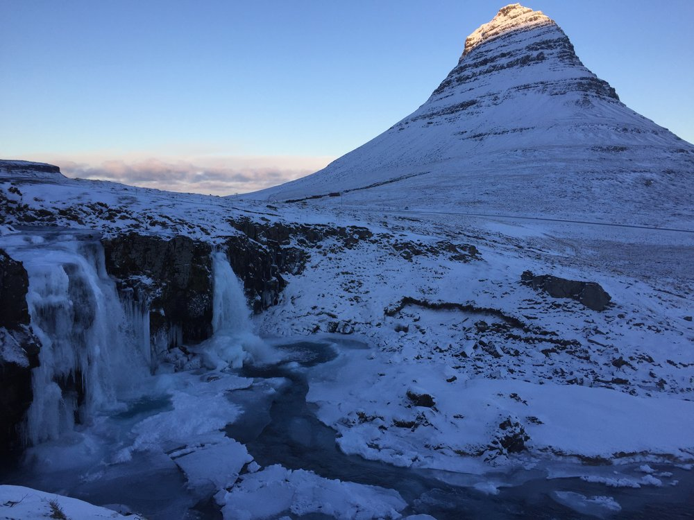 Frozen falls with mountain.JPG