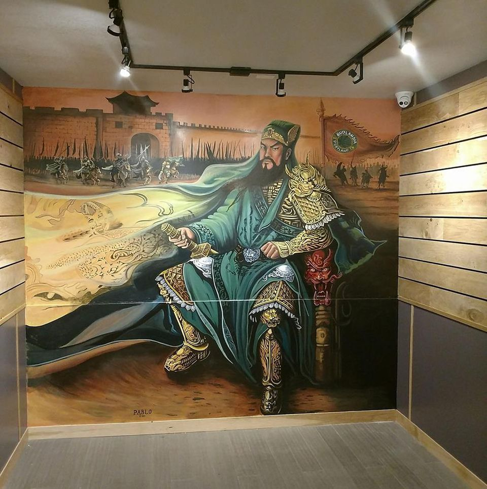 A floor-to-ceiling mural of the war general Guan Yu. Follow the mural artist at @pablosmurals on IG.PABLOS GONZALES