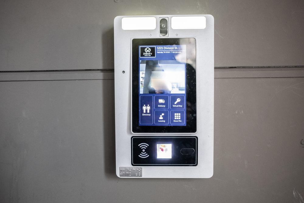 Touchscreen to enter building entrance.
