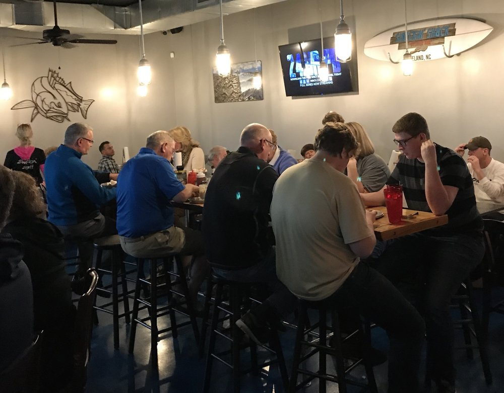 High top, booth or bar? Our newest Shuckin' Oyster Bar & Sports Pub in Leland, NC can accommodate every customer and all members of your family!