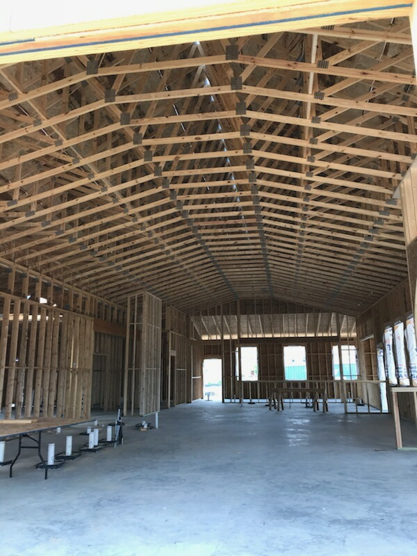 Just a week or two away from being completely under roof and having windows and doors so the interior work can begin!  Where should we hang the surfboard?