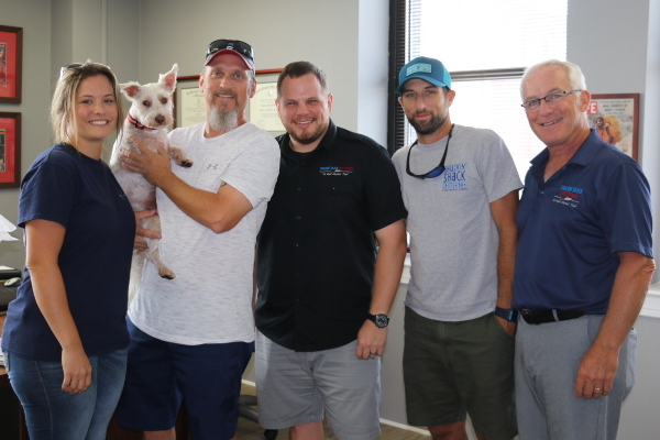 The Harrdy, LLC group are on the left, with their mascot -Teddy, followed by Jonathan Weathington (CEO), Matt Piccinin (Co-Founder) and Mario Piccinin (VP of Franchise Development)