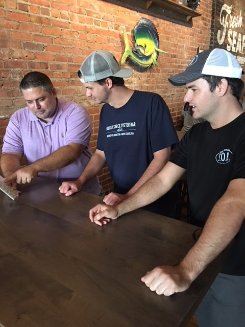 Barry (left) of the Wilmington Shuckin' Shack training Austin the GM and Darin (right) the Front of House manager for Statesboro.