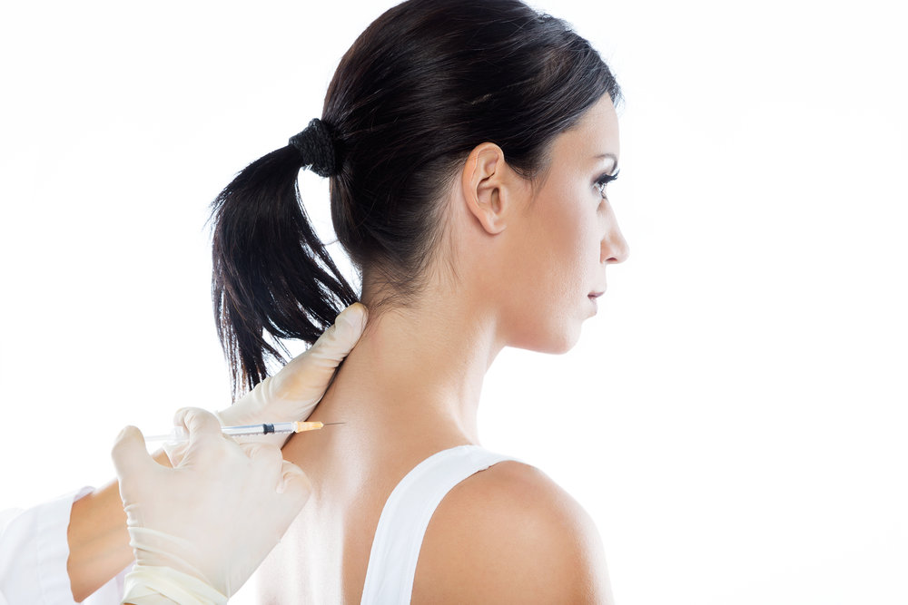 Surgeon making injection into female body. Neural therapy concept.