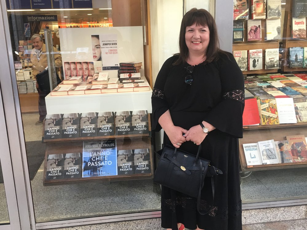 Here I am outside Hoepli in Milan, where Cecilia, my wonderful host at Corbaccio, surprised me with this amazing window display. I signed about forty books inside, and had a tour of the five floors - what a beautiful bookstore.