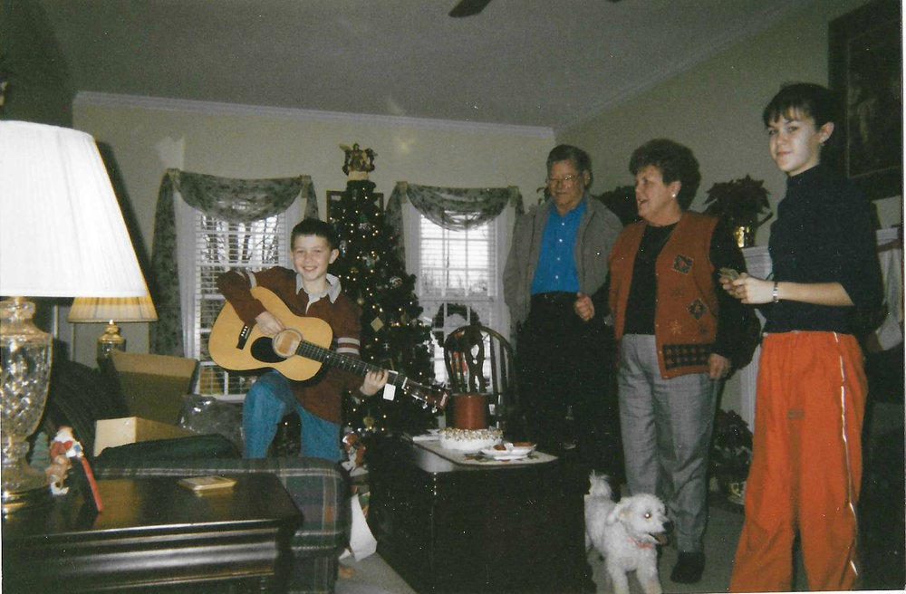 Scotty pictured with his first guitar.